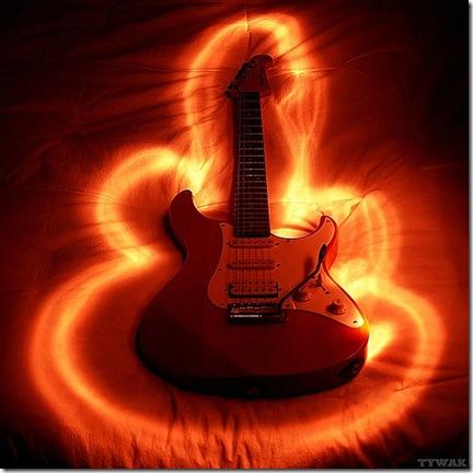 Apprendre à jouer de la guitare électrique, le lit... le pied - Photo Tywak